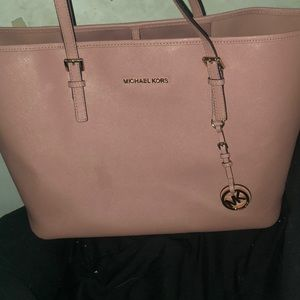 Like pink/purple *real* mike kors bad